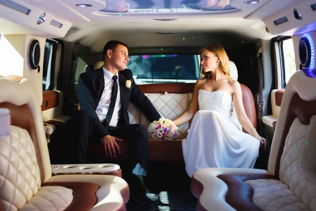 Wedding couple in a limo after their ceremony