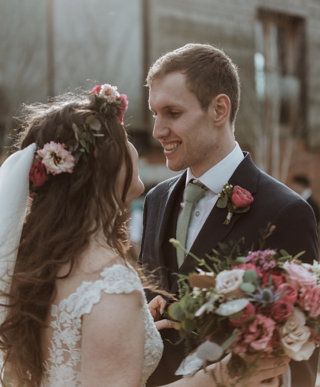 Bride and groom look into each others eyes