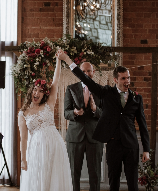 Bride and groom celebrate at the alter after getting married