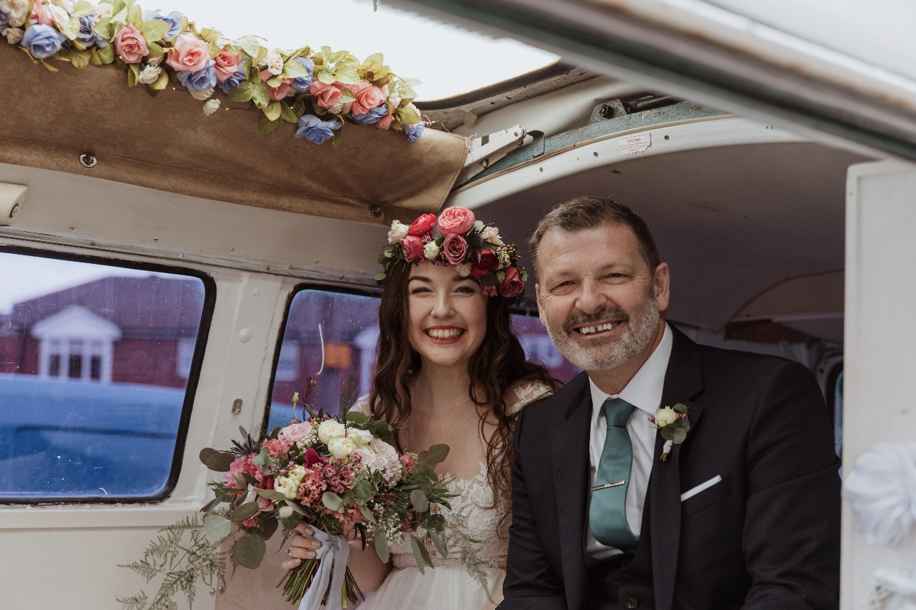 Bride and her father arrive in a VW campervan