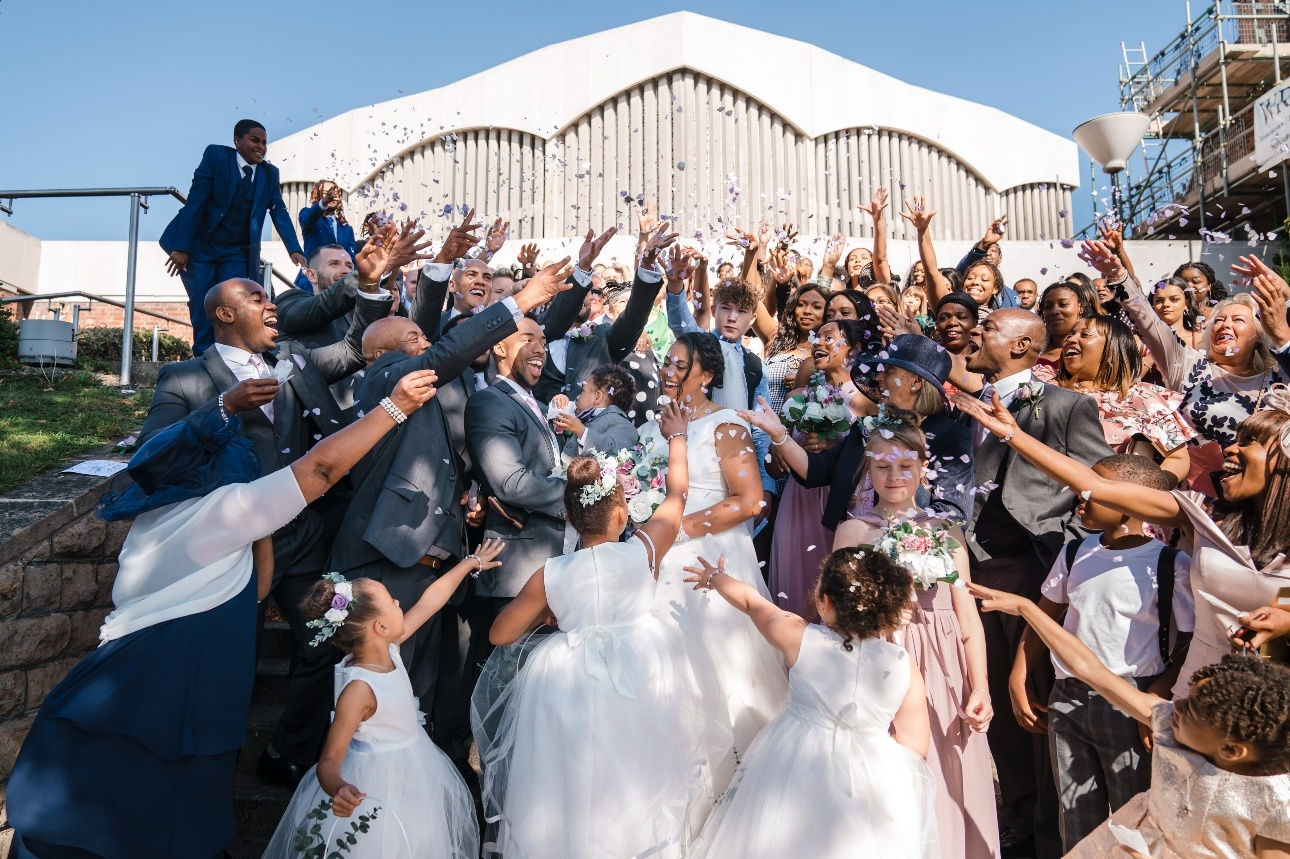 Bride and groom surrounded by loved ones