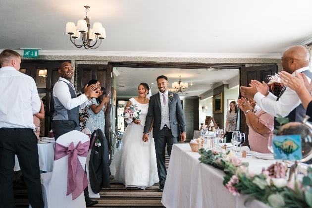 Newlyweds enter wedding reception