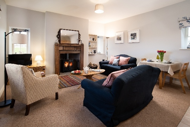 lounge with three sofas and fire
