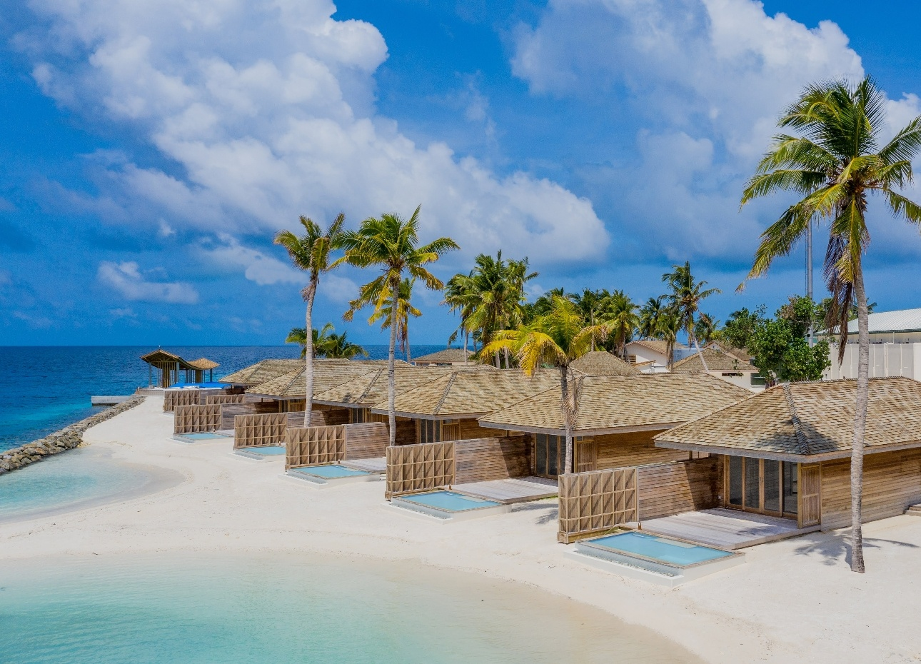 beach suites with individual pools and beach area and then main ocean view