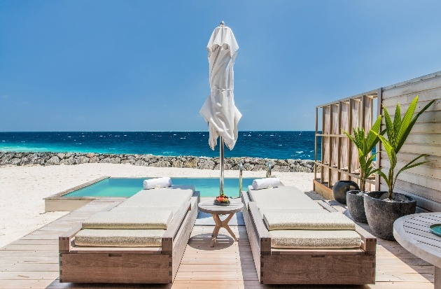 beach suite with private pool and two sun-loungers looking out to sea