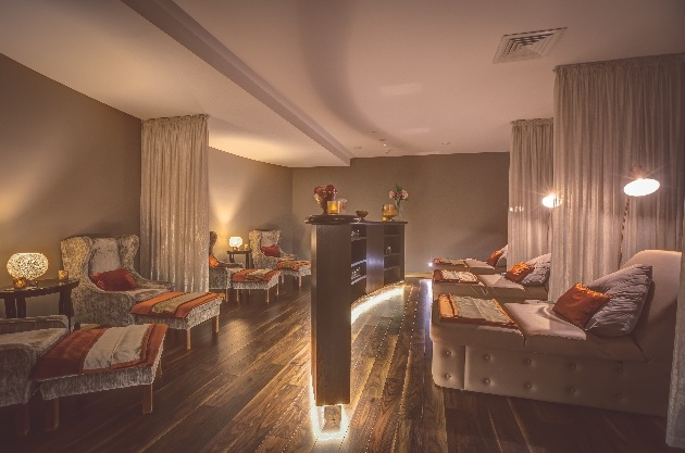 low lit spa suite leather chairs  and velvet recliners