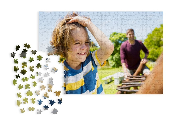 puzzle with a photo on it broken in to pieces