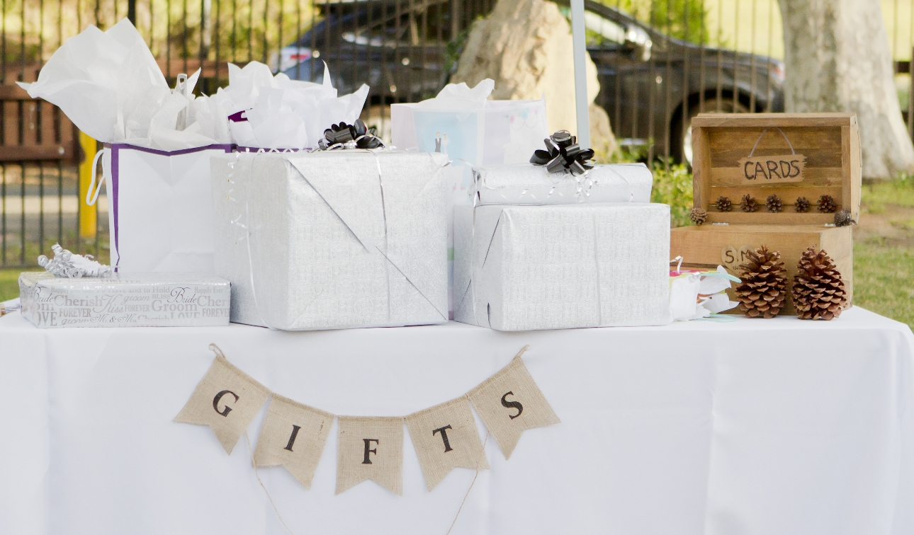 gift table with presents and a wooden box for cards